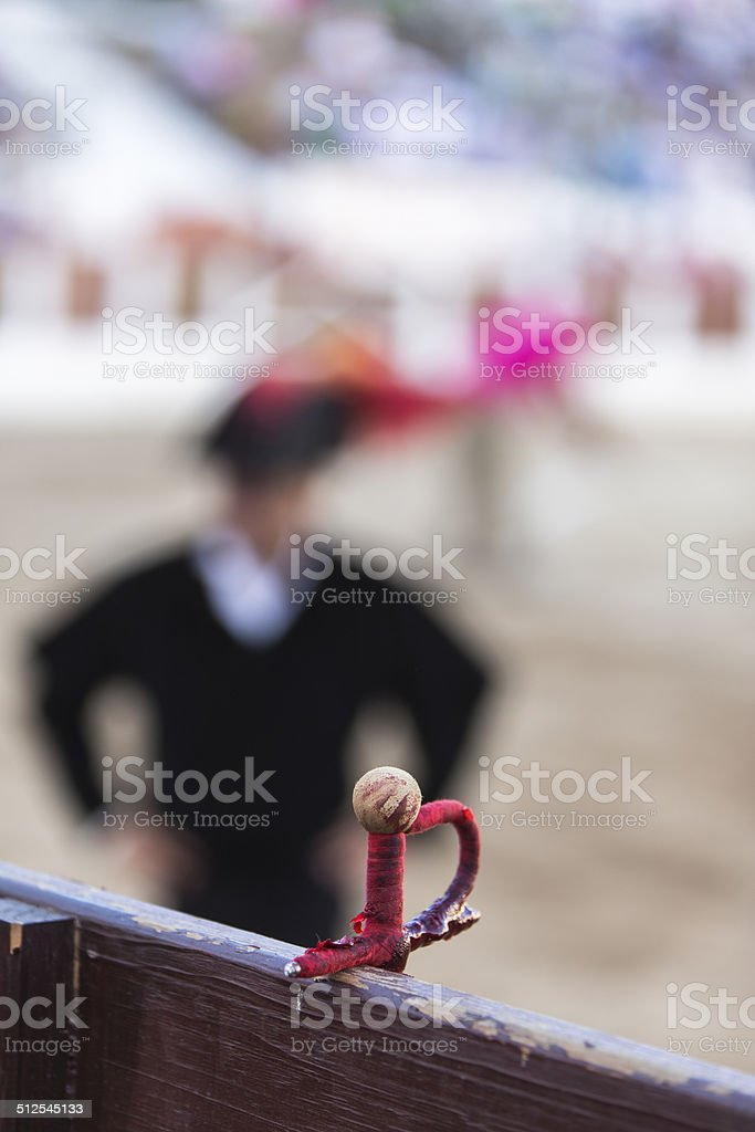 sword toreador supported on the burladero, Spain stock photo