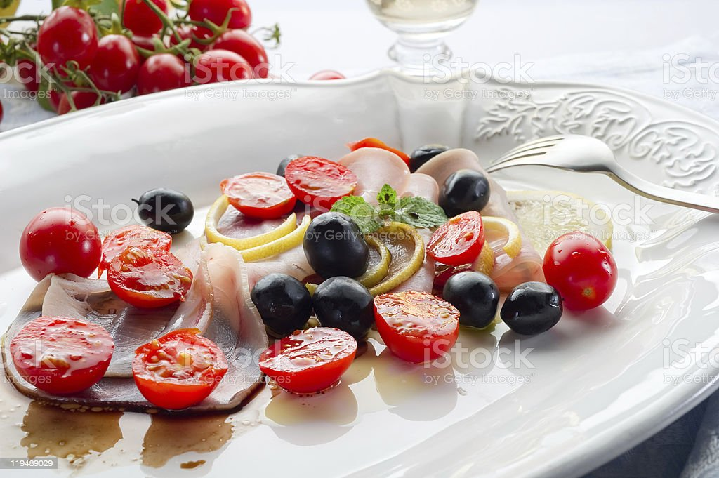 swordfish carpaccio with tomatoes and black olives royalty-free stock photo
