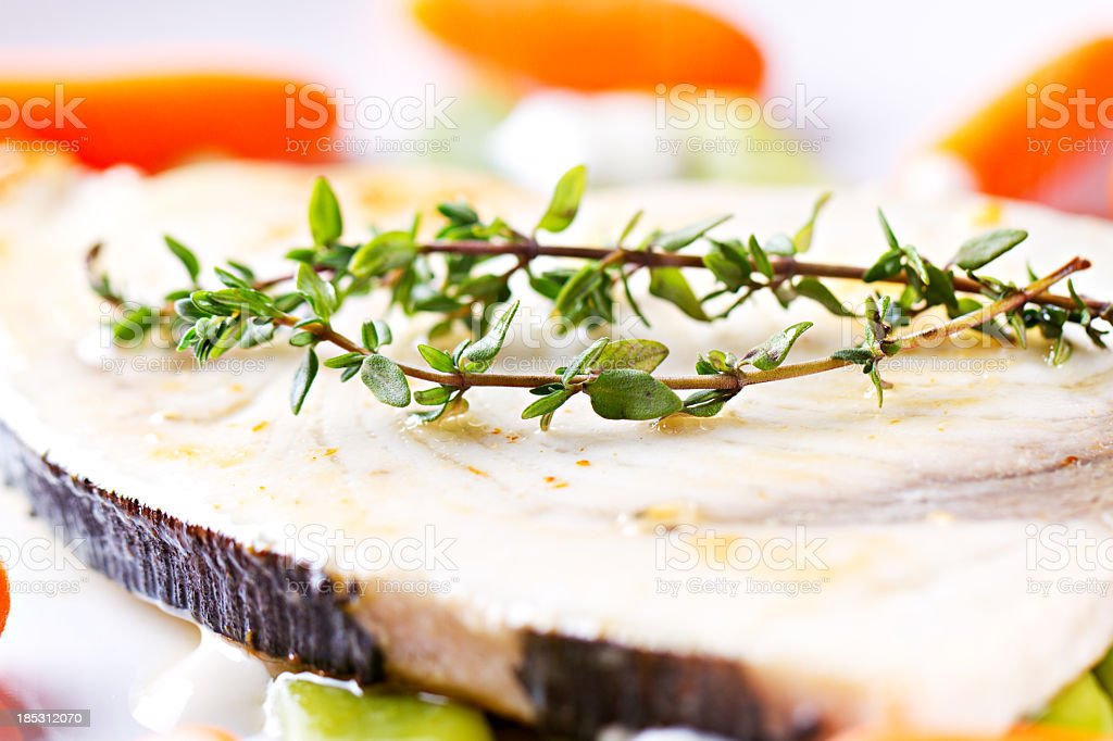 Swordfish grilled with mixed vegetables and yogurt sauce. stock photo