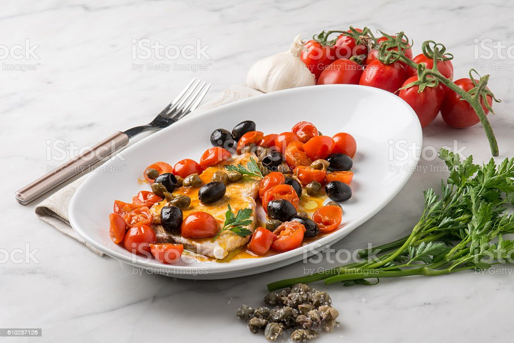 swordfish with tomatoes capers and olive stock photo