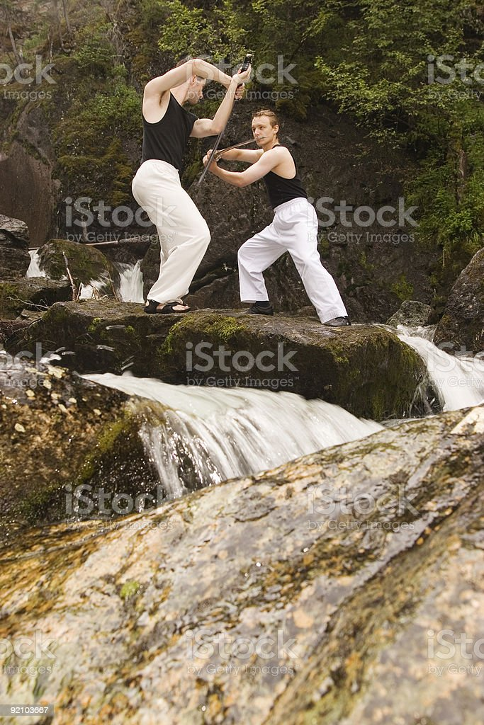 Swordsmen training outdoor stock photo