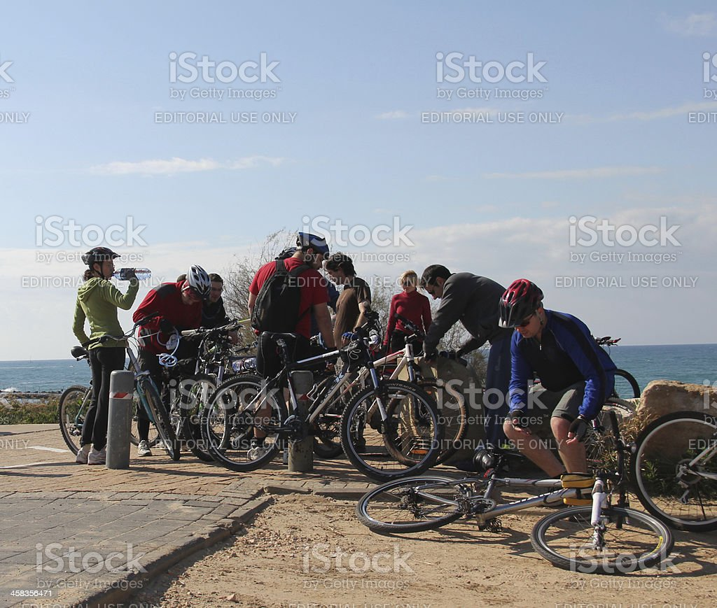 Сyclists stopping royalty-free stock photo
