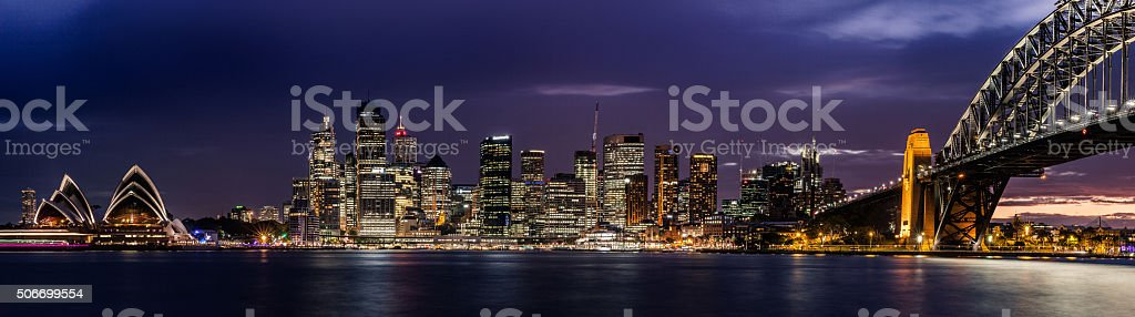 Sydney CBD and harbor illuminated at night stock photo