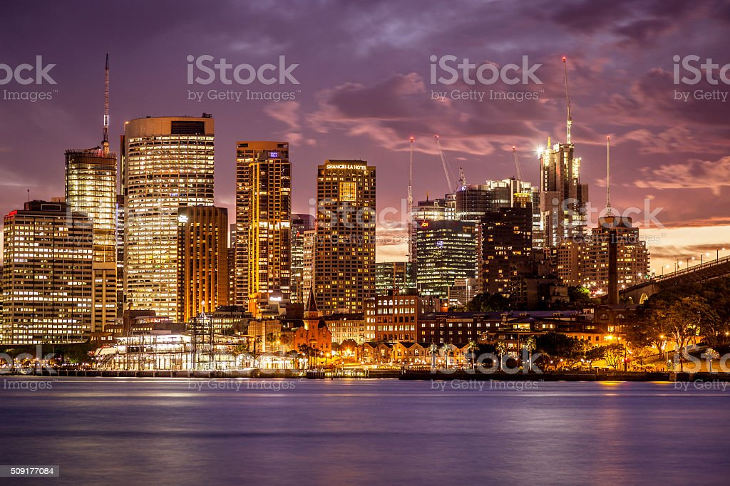 Sydney cityscape: lights and harbour with mauve sunset stock photo