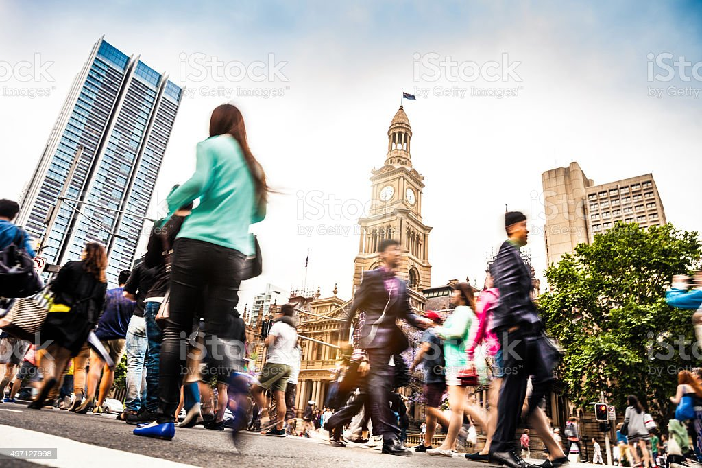 Sydney downtown, blurred intersection people and traffic stock photo
