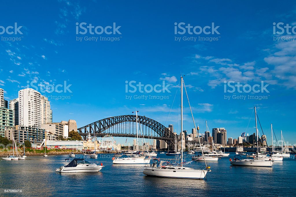 Sydney Harbour Bridge and cityscape with yachts stock photo
