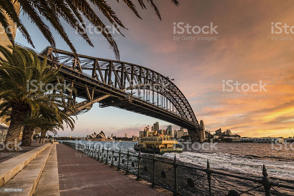 Sydney Harbour Bridge and Ferry at Dusk, Australia stock photo