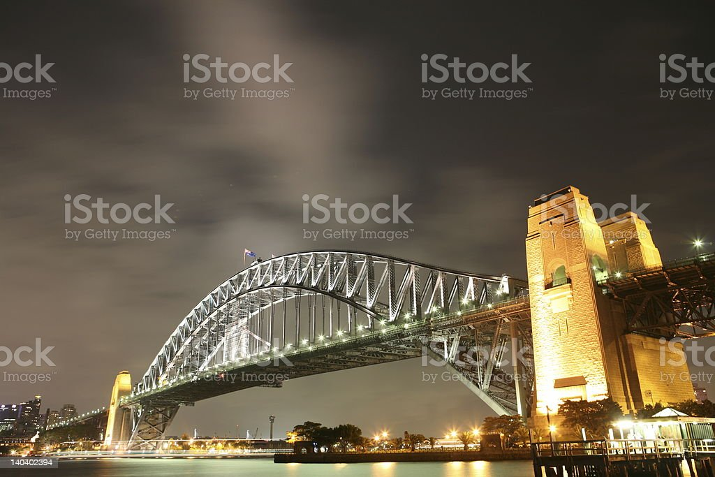 Sydney harbour bridge at night with sky effect royalty-free stock photo
