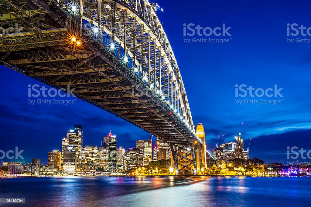 Sydney Harbour Bridge with downtown in the background at dusk stock photo