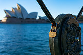 Sydney Opera House and heart-shaped lock with Chinese type