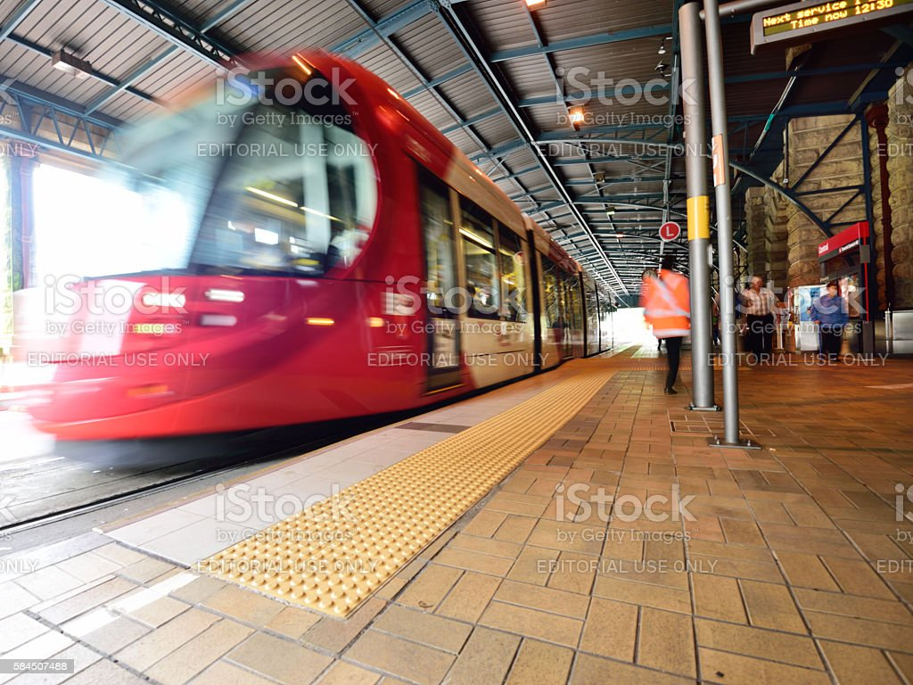 Sydney Tram, motion blurred at railway station. Motion blurred commuters. stock photo