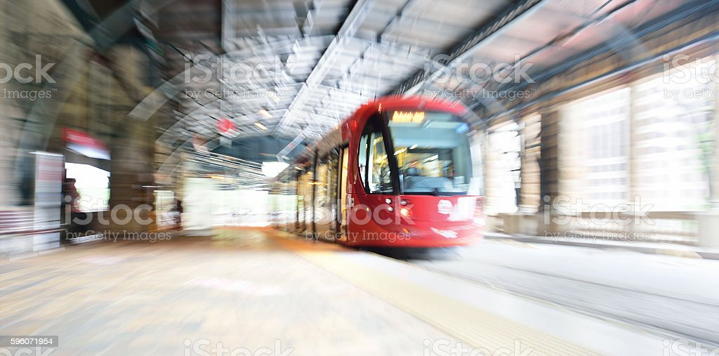 Sydney Tram, zoom and motion blurred at railway station stock photo