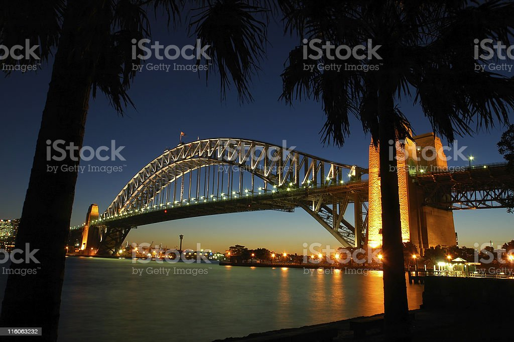 Sydney's Harbour Bridge seen lot at night through the trees royalty-free stock photo