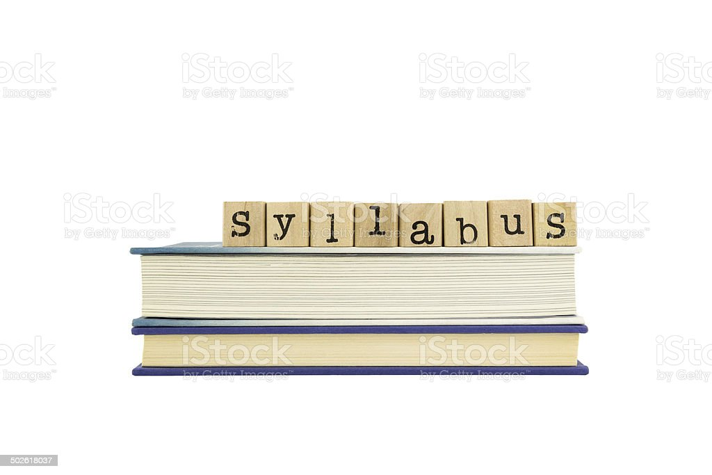 Syllabus word on wood stamps and books stock photo
