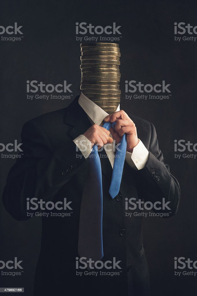 Symbol, Businessman with coins instead a head stock photo