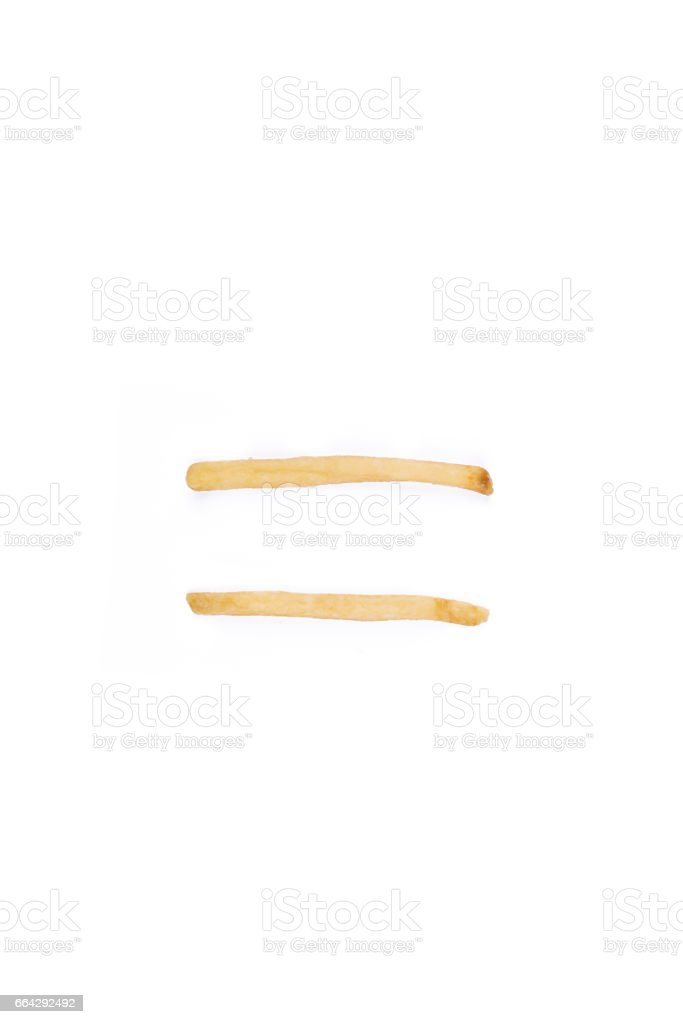 Symbol equal sign laid with french fries. stock photo