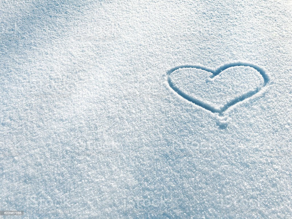 Symbol of heart on the background of fresh snow stock photo