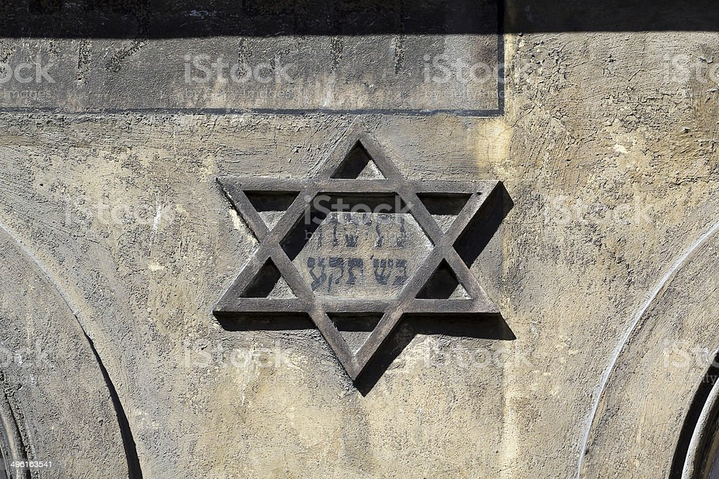 symbol of jewish star of david on the front on old building stock photo