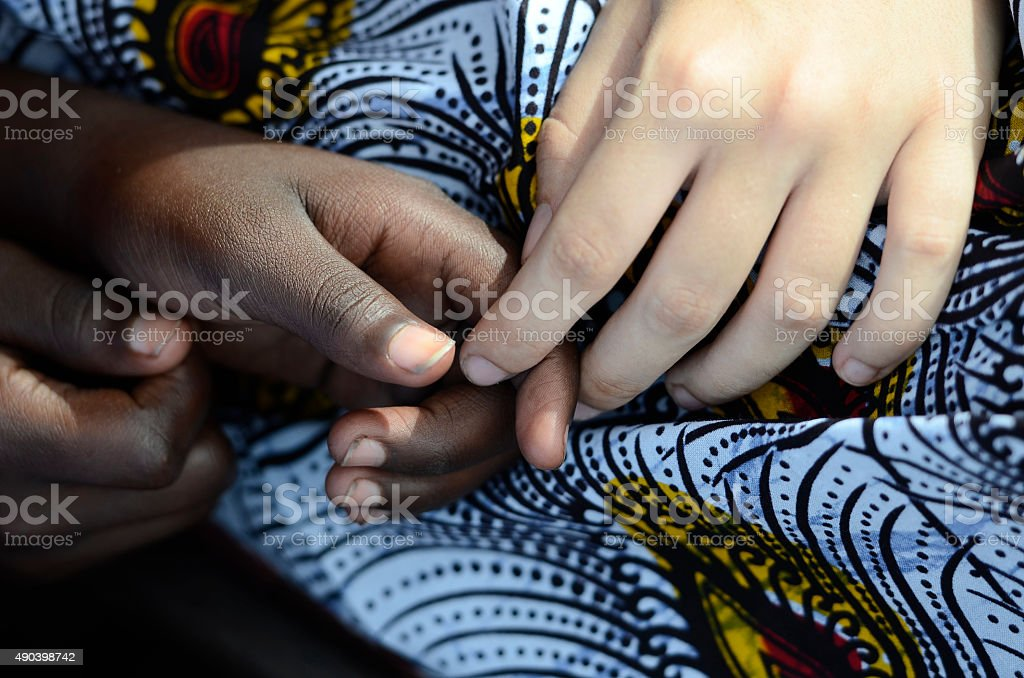 Symbol Of Peace - Black and White Women Holding Hands stock photo