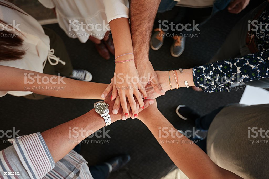 Symbol of teamwork, cooperation and unity stock photo