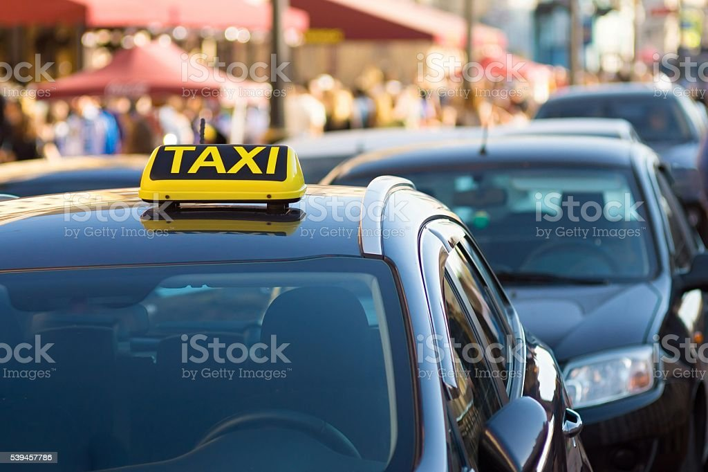 symbol or sign of taxi on a car roof stock photo