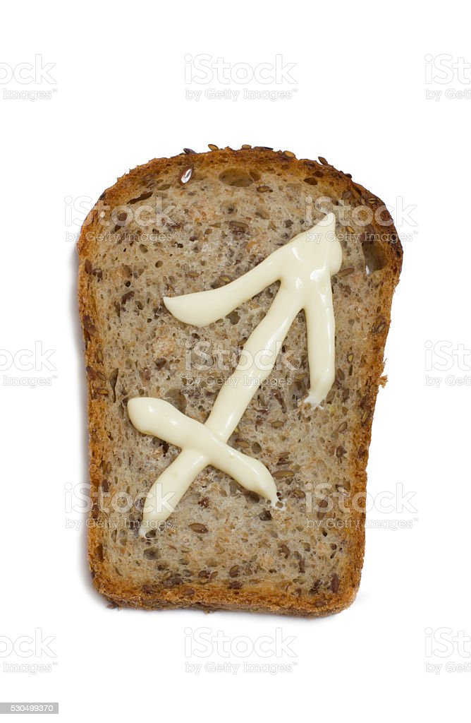 symbol the sagitarius on a piece of bre stock photo