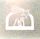 symbolic christmas crib scene - paper silhouette on textured background
