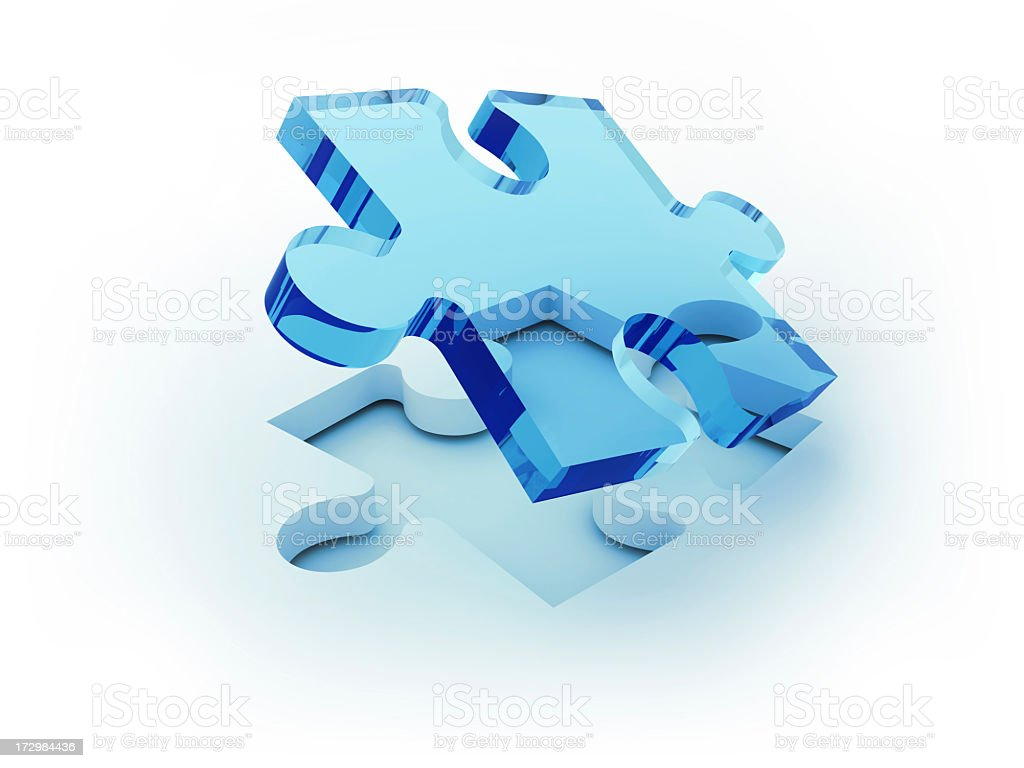 Symbolic clear blue puzzle piece emerging out of white space royalty-free stock photo