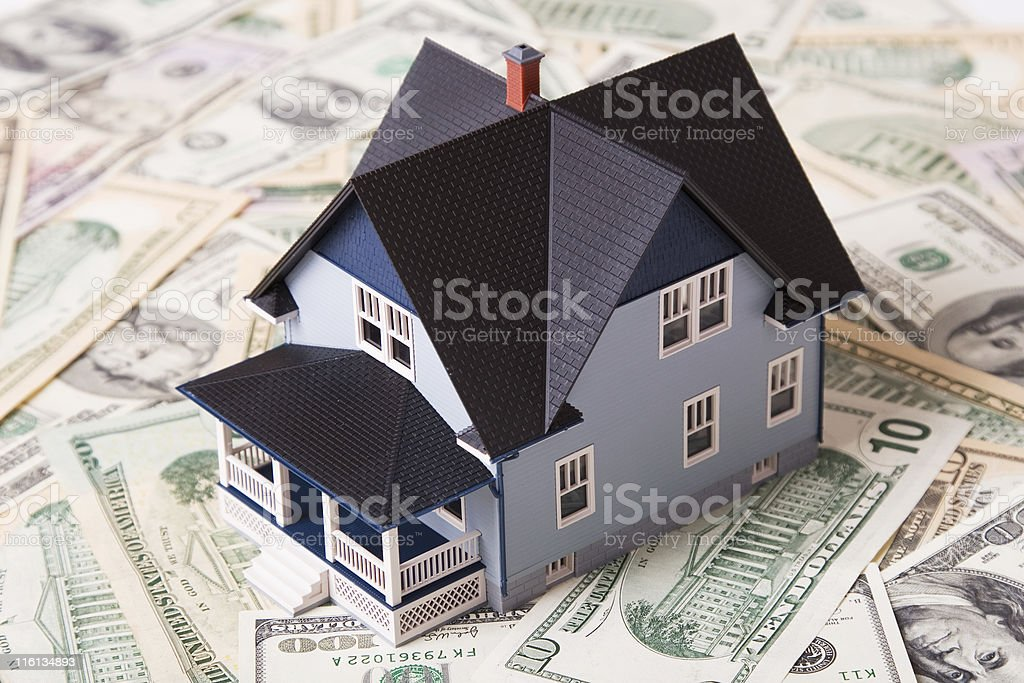 House standing on a different dollar bills. Real estate concept.