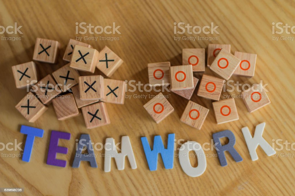Symbolizing teamwork with wooden blocks and colored letters stock photo