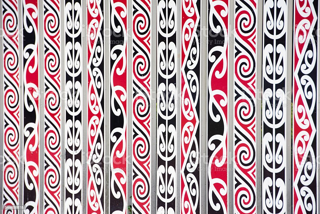 Symbols and Maori decorations painted on the fence stock photo