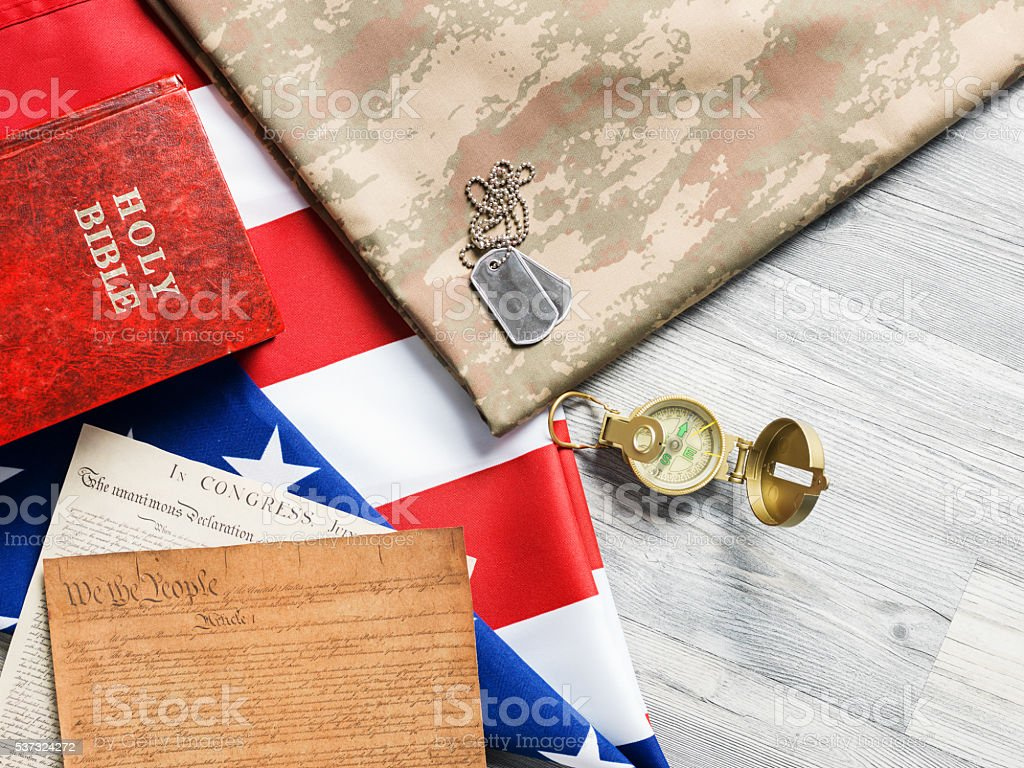 Symbols Of Patriotism And Military On Gray Wooden Floor stock photo