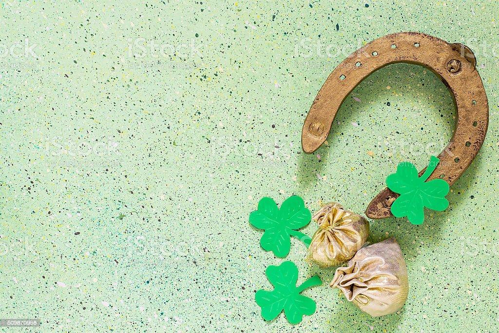 Symbols of St. Patrick's Day: horseshoe, shamrock clover, bags o stock photo