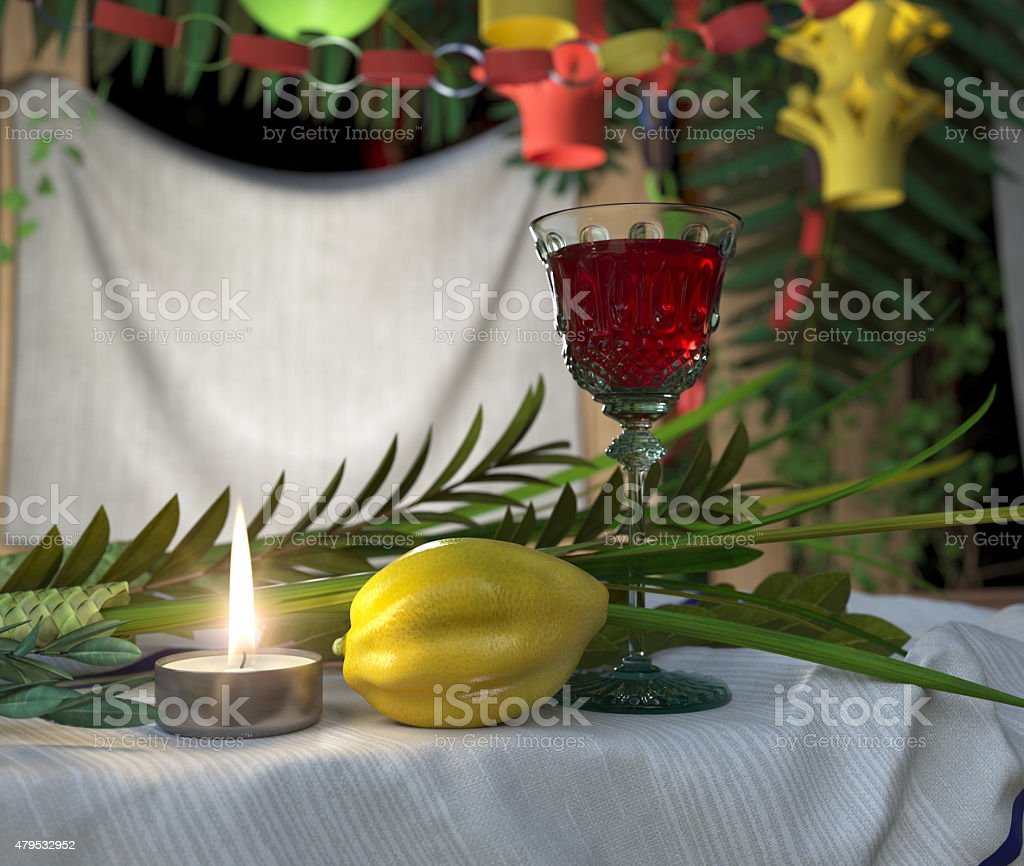 Symbols of the Jewish holiday Sukkot with candle and wine stock photo