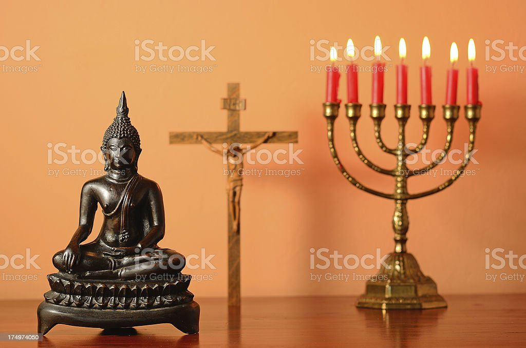Symbols of world religion on brown table stock photo