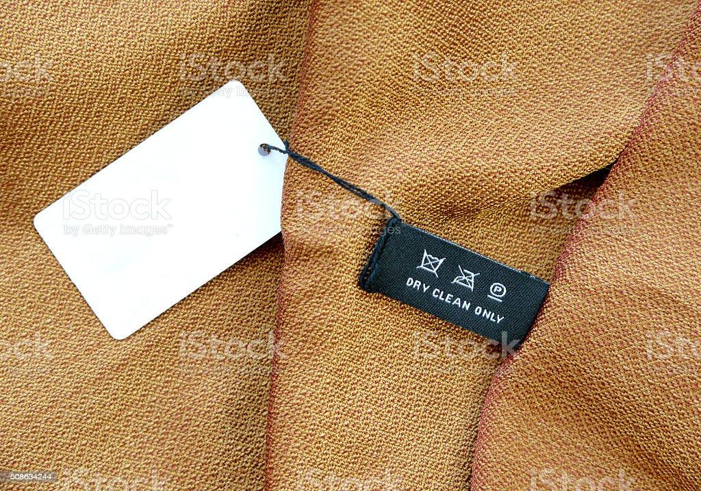 symbols set on clothing label on silk fabric stock photo
