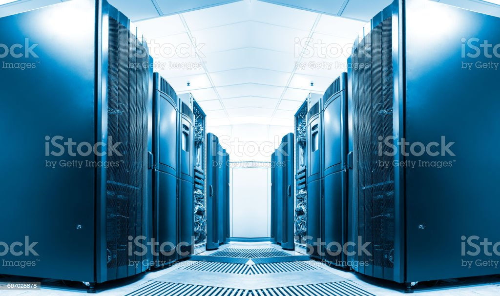symmetrical data center room with rows of equipment stock photo