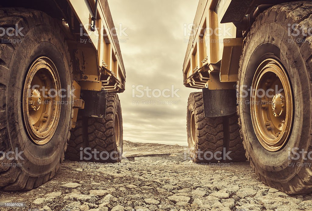 Symmetrical Dump Trucks stock photo