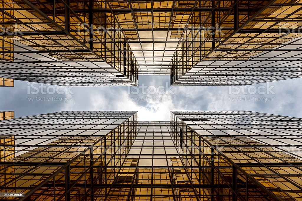 Symmetrical mirrored office buildings stock photo