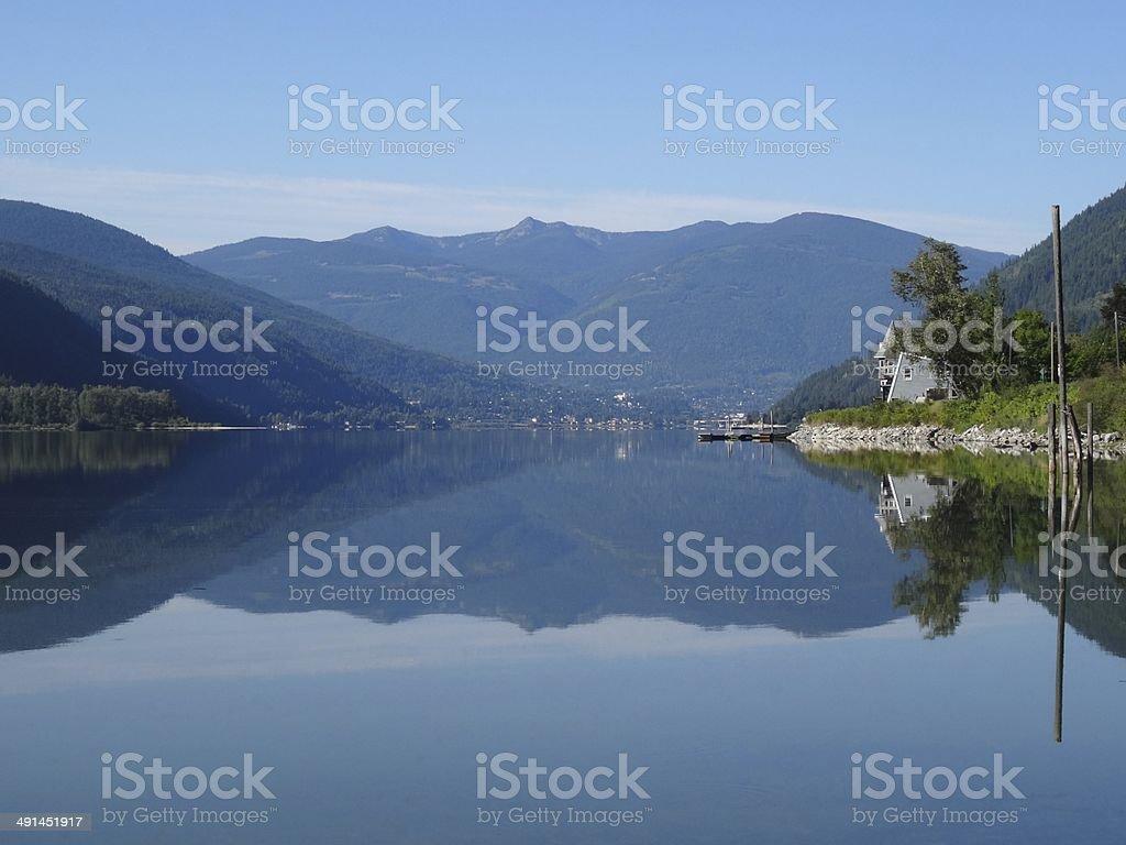 Symmetrical reflections in Kootenay Lake, Canada. royalty-free stock photo