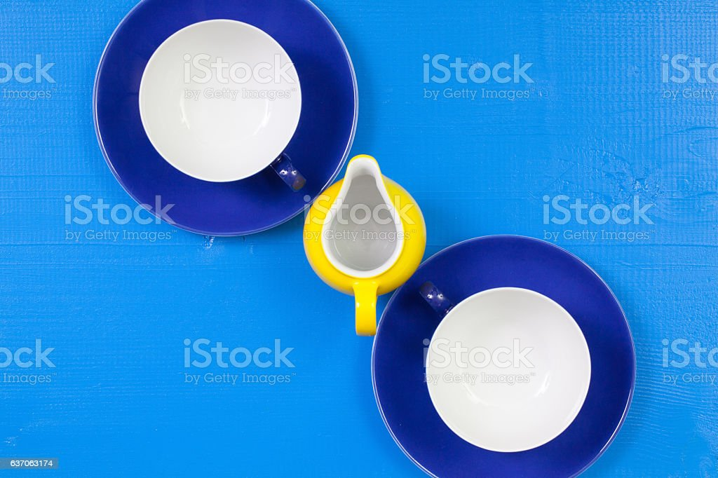 Symmetry  arrangement empty cups of tea on blue wooden table stock photo