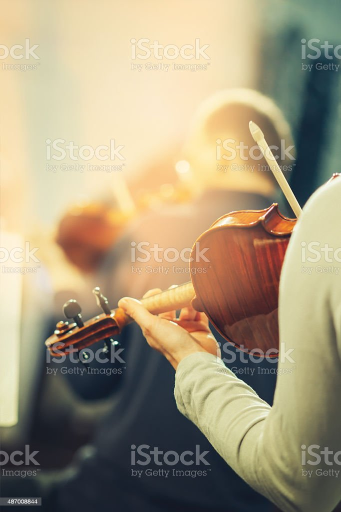Symphony orchestra on stage, hands playing violin stock photo