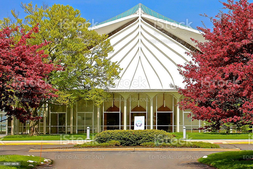 Synagogue white exterior main sanctuary entrance, spring tree color leaves stock photo