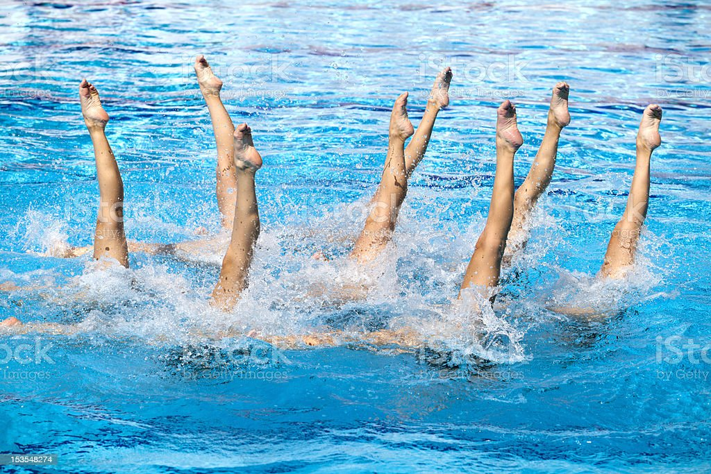 Synchronized swimmers legs movement stock photo