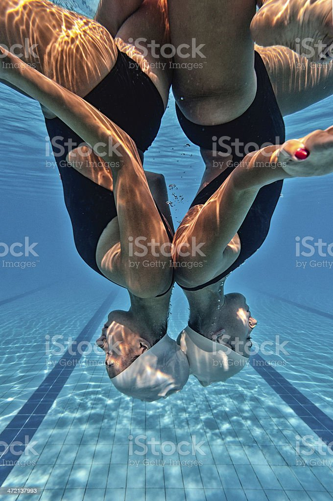 Synchronized swimmers upside down stock photo