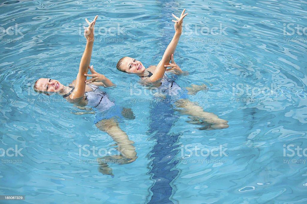 synchronized swimming training stock photo