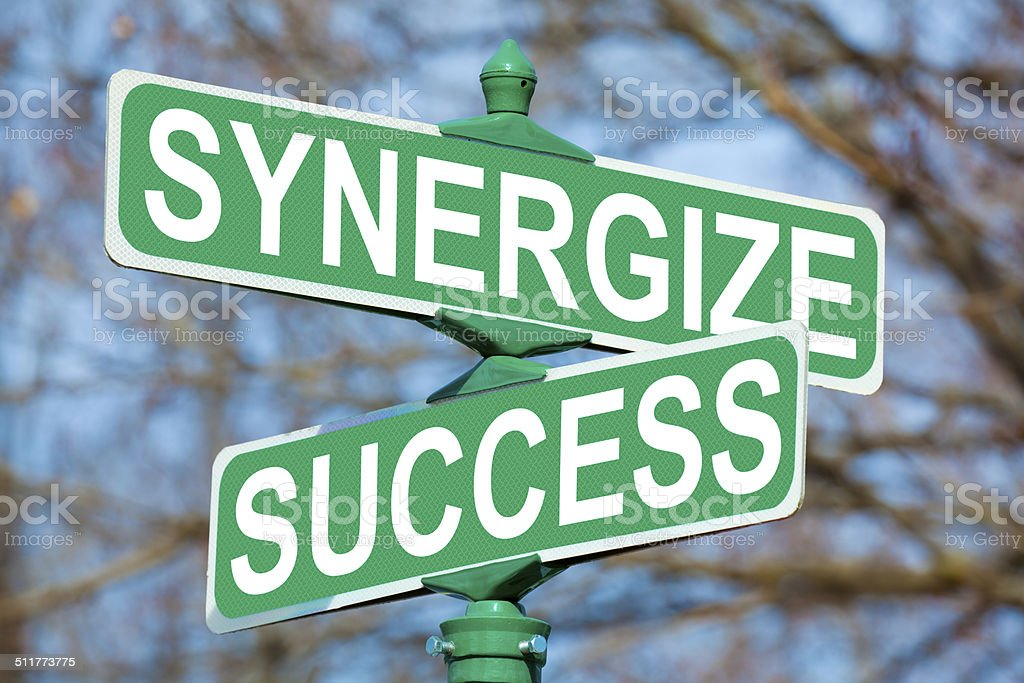 Synergize Success Street Sign stock photo