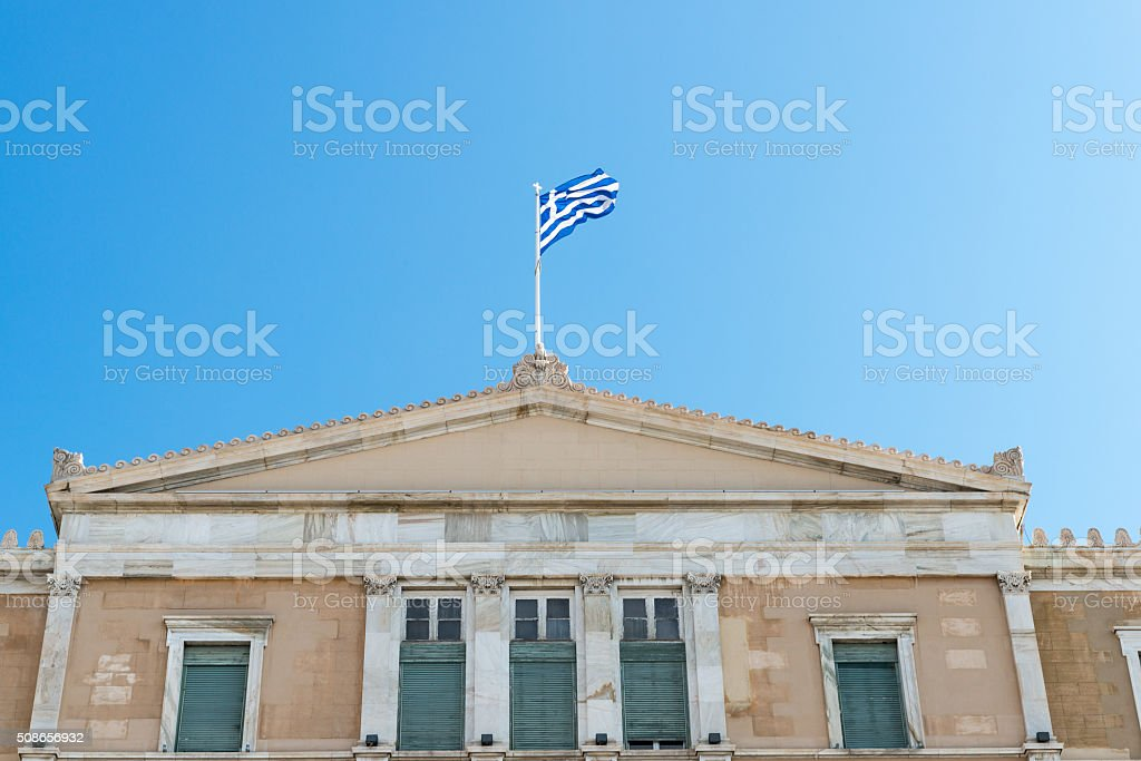 Syntagma Palace with Greek flag waving stock photo