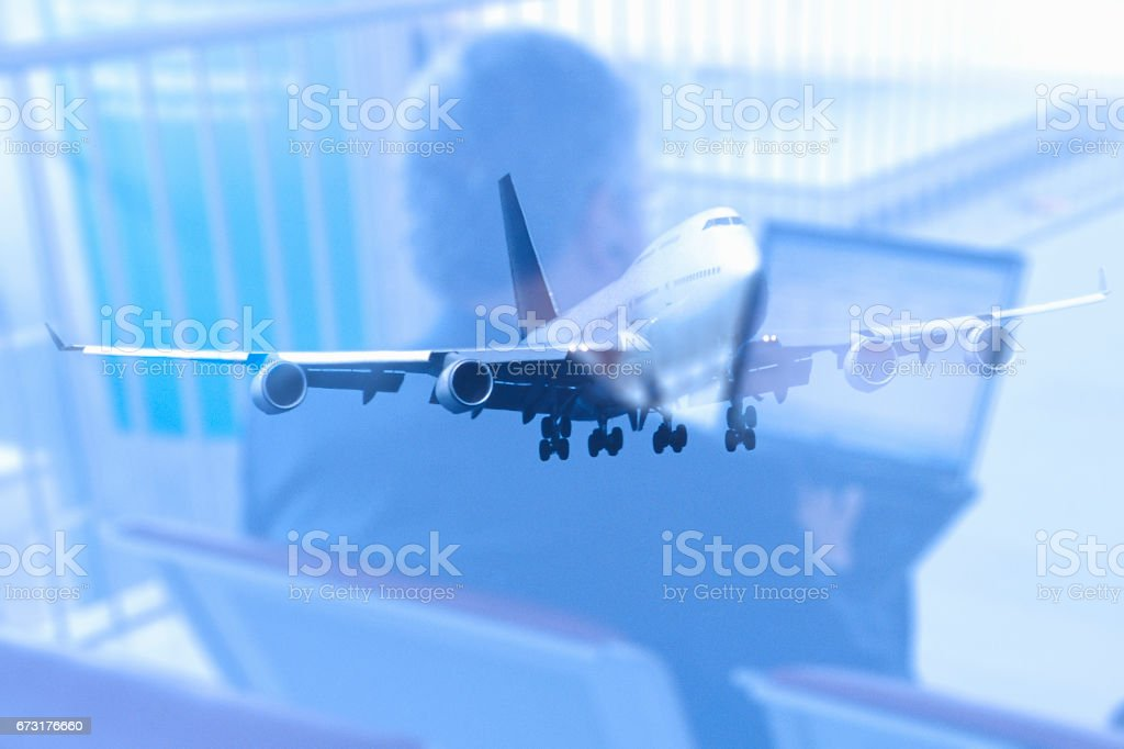 Synthesis of businessman and airplane stock photo