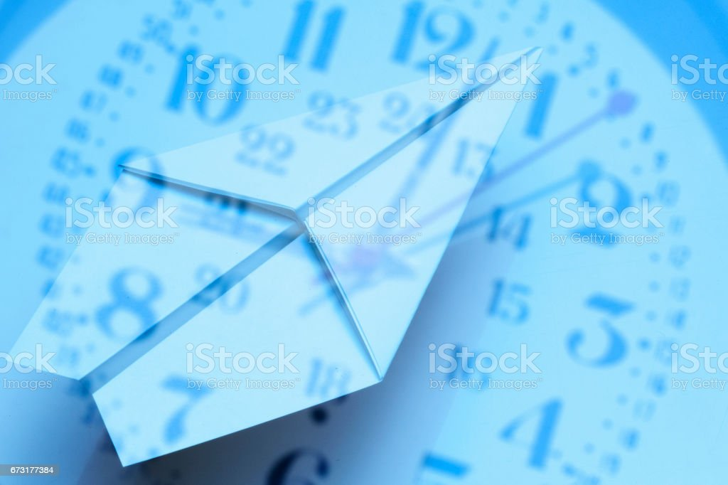 Synthesis of clock and paper airplanes stock photo